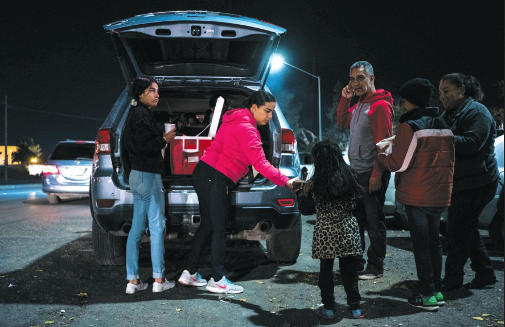 Maritza Gurrola (left), 15, and her mother Alicía Hernández, 40, both of Cuidad Juárez, hand out bread and hot chocolate to asylum-seekers. In a new poll, 40% of the respondants said they or a family member planned to migrate to the U.S.