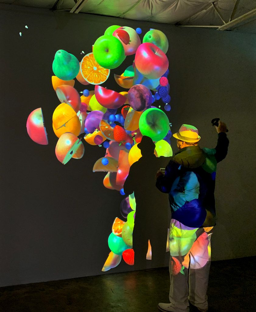 "An opening night guest interacts with Womb, 2019, a virtual reality animation with sound, at the opening of ""Jennifer Steinkamp: Womb"" at Talley Dunn Gallery on Aug. 23, 2019."