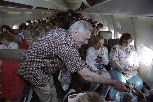 Southwest Airlines' Herb Kelleher passes out peanuts to customers on a flight from Dallas to San Antonio in 1991.