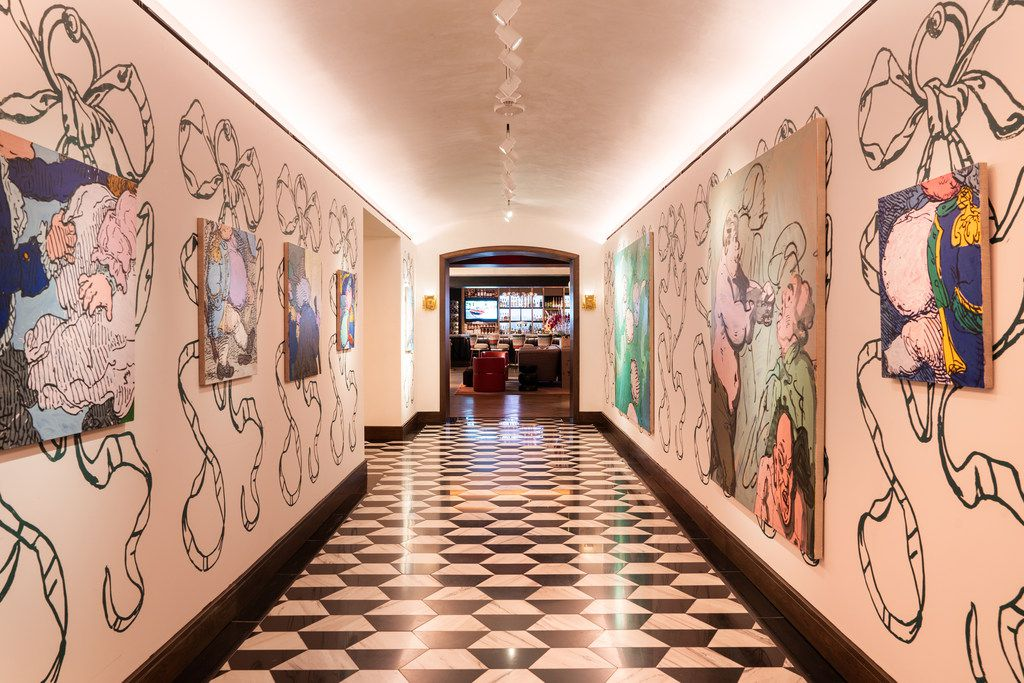 The main hallway in Park House with a display of work from artist Charlie Billingham.