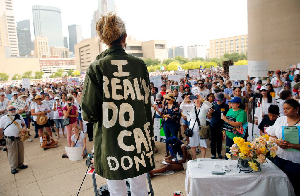 """Actress and activist Cheryl Allison wore a """"I Really DO Care, Don't U"""" green jacket as she spoke during the Keep Families Together rally  at Dallas City Hall on June 30, 2018. The jacket mocks the one first lady Melania Trump wore, which said the opposite. The rally and march was part of a nationwide effort  protesting President Donald Trump's zero-tolerance border policy."""