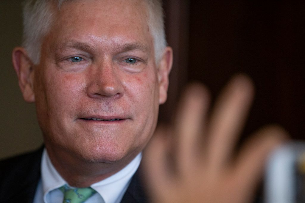 Congressman Pete Sessions takes pictures with supporters at his luncheon at Dallas Athletic Club in Dallas on Thursday, October 18, 2018.