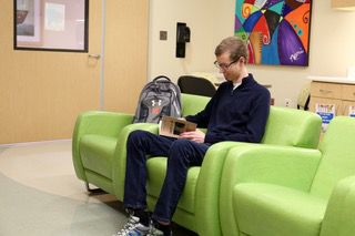Cancer patient Rusty Vittrups, with his Carson Leslie Foundation-provided Under Armour backpack, relaxing in the Carson's Corner teen room on the sixth floor of Children's Health Dallas.
