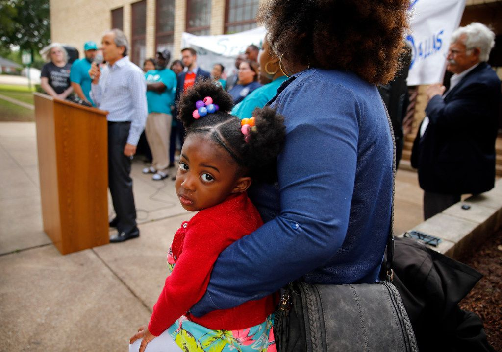 Joi Murrel, 2, joined her mother, Shatrease Murrel, at Thursday's news conference announcing the launch of the Strong Schools Strong Dallas coalition, a diverse group of North Texas organizations supporting a Tax Ratification Election (TRE), that if passed could mean $100 million in additional funding for the Dallas ISD. (Tom Fox/Staff Photographer)