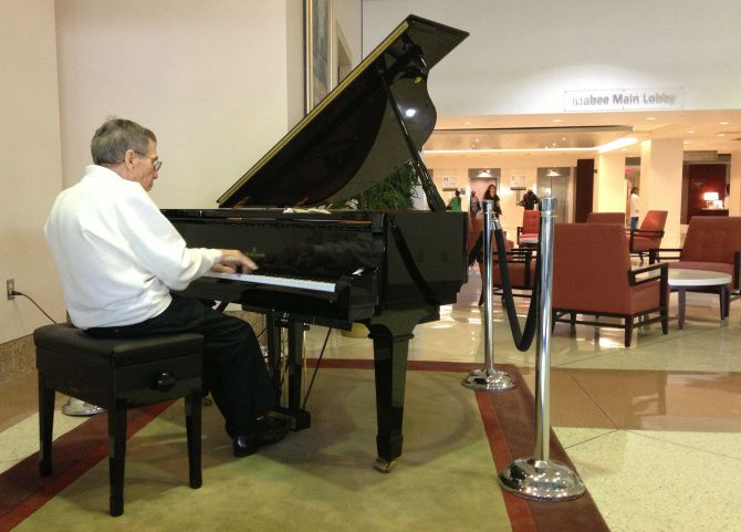 Lucien Leinfelder, an 80-year-old Parkinson's patient, performs at Texas Health Presbyterian of Dallas, where he's being treated. He practices two hours every day.