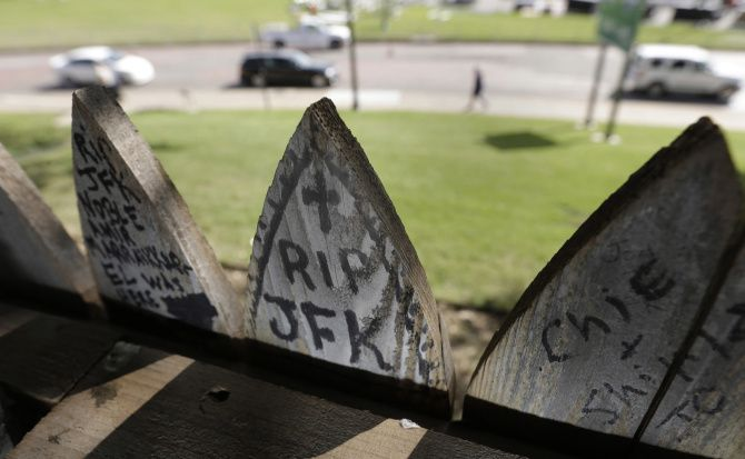 The view from behind the picket fence that stands above the grassy knoll in Dallas.