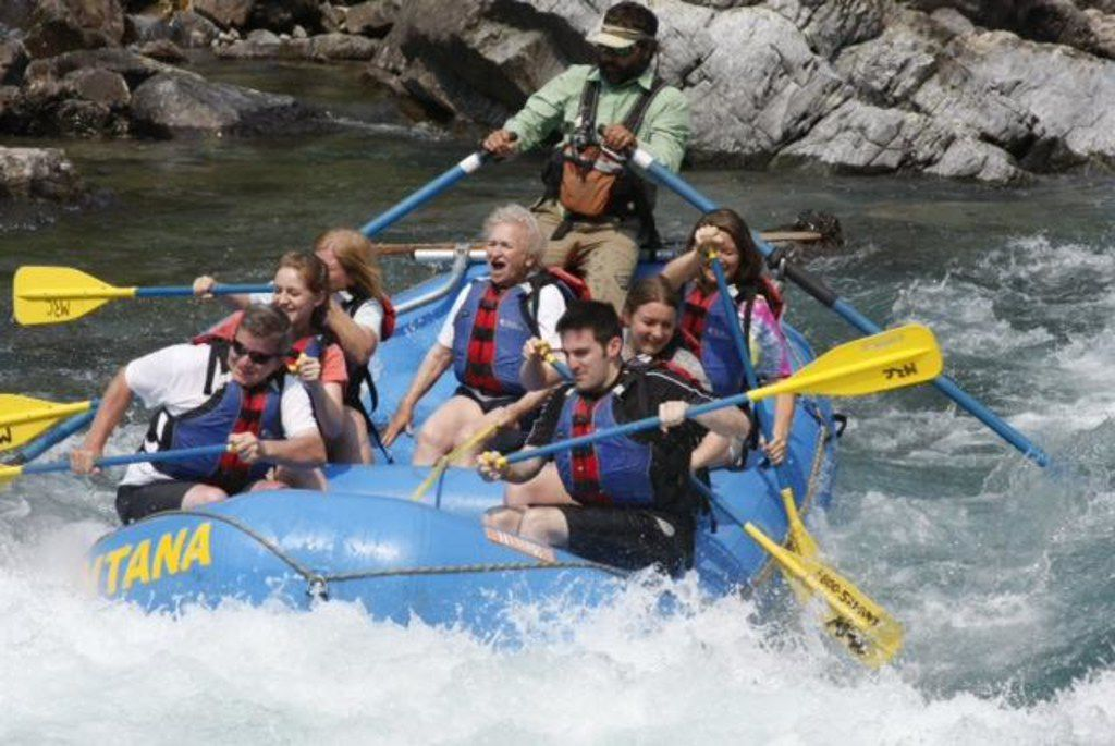 Nancy McCall (center), Nanette Light's grandmother, screams during a rafting trip as Light (second from bottom on right) and the rest of her family paddle at Glacier National Park in 2013.
