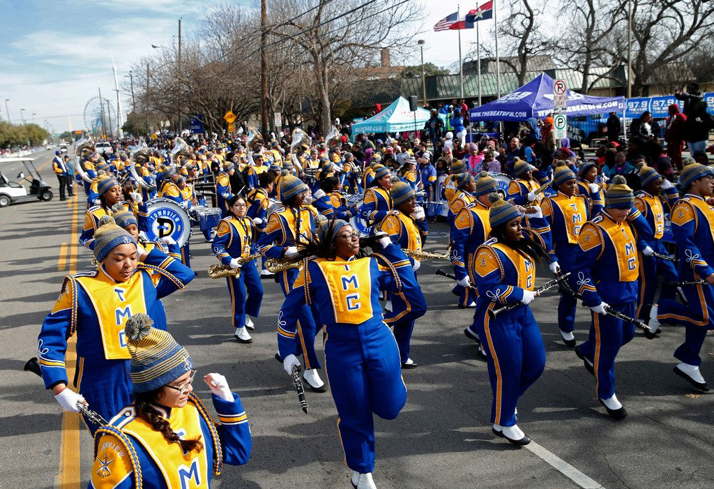 Townview Magnet Center marching band dances as they make their way down Martin Luther King Jr. Blvid. during the 37th Annual MLK Parade in Dallas on Saturday, January 21, 2019. (Vernon Bryant/The Dallas Morning News)
