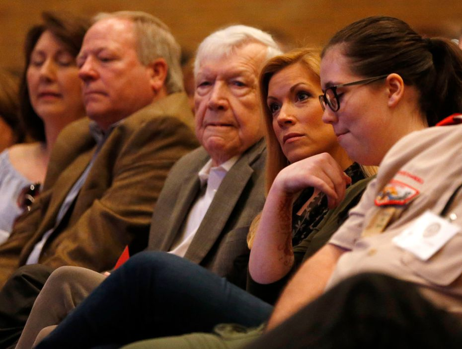 Irving Mayor Beth Van Duyne listens during as Rep. Pete Sessions, R-Dallas, speaks during a town hall meeting at Richardson High School on Saturday. (Vernon Bryant/The Dallas Morning News)