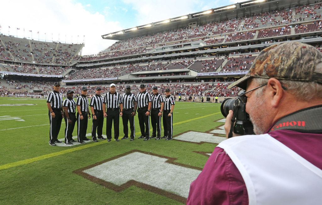 The SEC officiating crew breaks gets a group photo made before opening kickoff during the  Louisiana Lafayette Ragin' Cajuns vs. the Texas A&M Aggies at Kyle Field in College Stadium, Texas on Saturday, September 15, 2017. (Louis DeLuca/The Dallas Morning News)