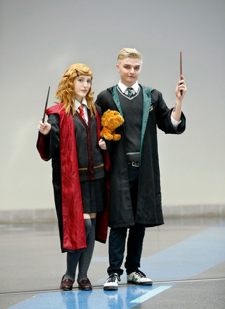 Austin Harry Potter fans Sophie Durre (left), dressed as Hermione Granger, and her boyfriend Brandon Smith, dressed as Draco Malfoy, pose for a photo following the costume contest at LeakyCon Dallas at the Kay Bailey Hutchison Convention Center in Dallas.