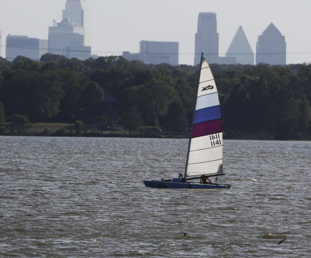 A sail boat navigates White Rock Lake in Dallas late Saturday afternoon July 18, 2015, as temperature almost reaches 100 degrees.