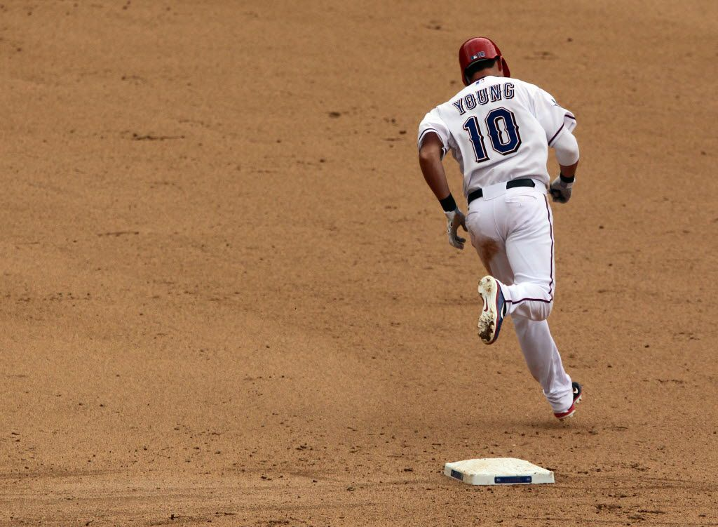 Texas infielder Michael Young circles the bases after hitting a homer during the Texas Rangers vs. Seattle Mariners major league baseball game at Rangers Ballpark in Arlington  on Thursday, April 12, 2012. (Louis DeLuca/The Dallas Morning News)