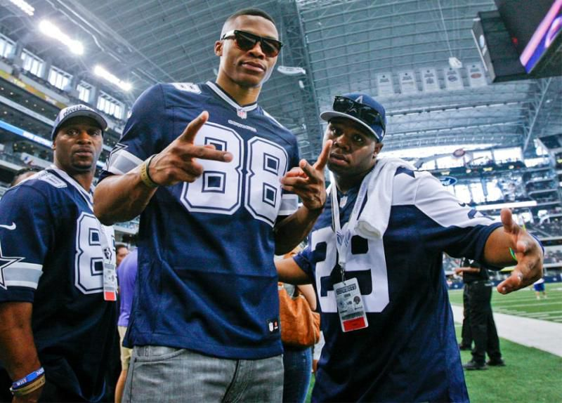 NBA star Russell Westbrook of the Oklahoma City Thunder stands on the sidelines before an NFL football game on Sept. 23, 2012, in Arlington.