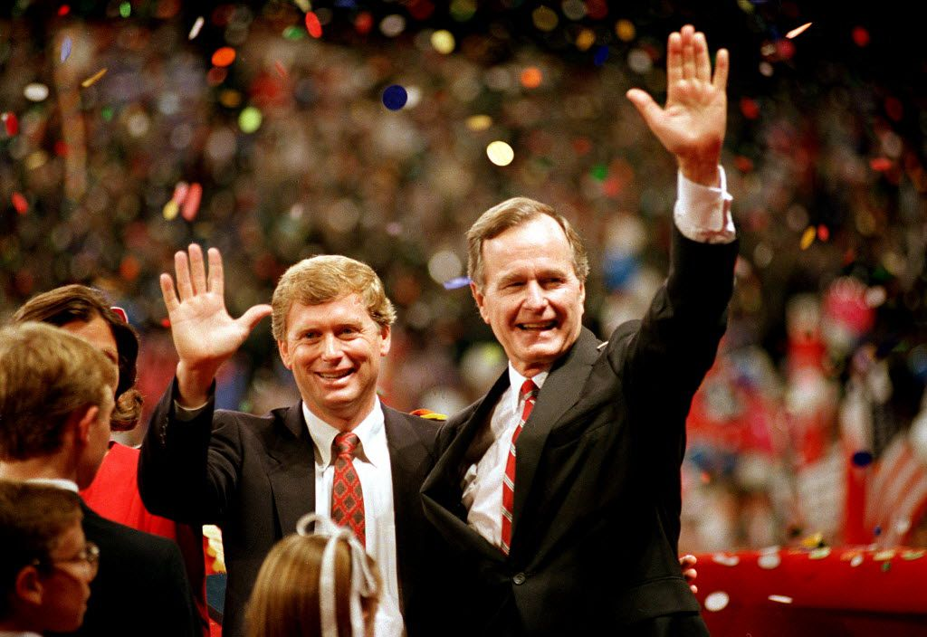 """In this Aug. 18, 1988, photo,  Vice President George Bush and his running mate, Indiana Sen. Dan Quayle, wave at the Republican National Convention in New Orleans, after their acceptance speeches. Bush's included the famous line: """"Read my lips. No new taxes."""""""