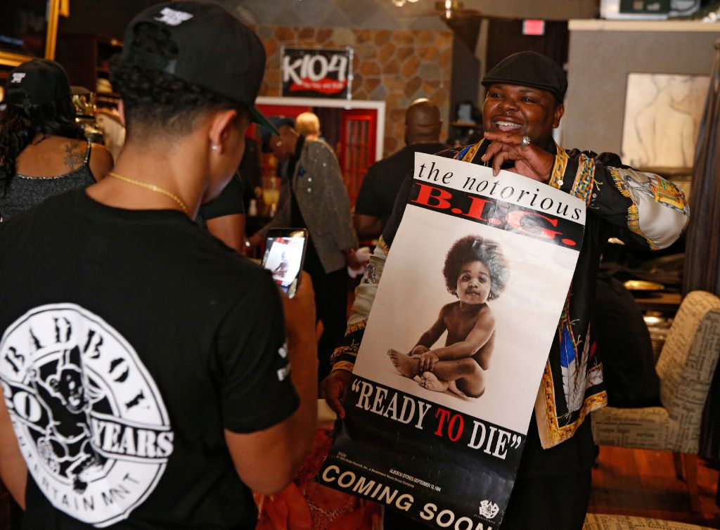 Brett White (right) does a snapchat video filmed by Rafael Amaro at pop-up store featuring Bad Boy products at  Guns and Roses Boutique in Dallas, TX Sept. 14, 2016.