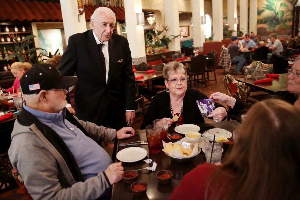 Alfred Martinez (top left), who is a member of the founding family of El Fenix, speaks with Shirley Williams (top right), her husband Don Williams (left), Michaela Bellas (bottom) and Lisa Haar (far right) while they dine in El Fenix in the Dallas restaurant Thursday December 14, 2017. El Fenix Mexican Restaurant will be celebrating being open for 100 years in 2018. The Williams had their wedding reception at the restaurant 35 years ago, and as a group eat at the restaurant every week. (Andy Jacobsohn/The Dallas Morning News)