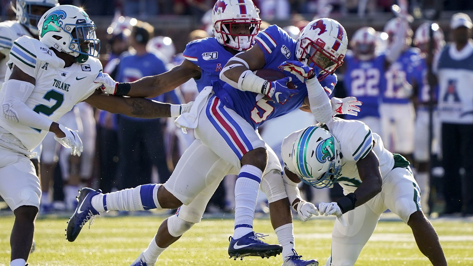 SMU running back Xavier Jones (5) is brought down by Tulane cornerback Jaylon Monroe (9) on a 38-yard run during the first half of an NCAA football game at Ford Stadium on Saturday, Nov. 30, 2019, in Dallas.