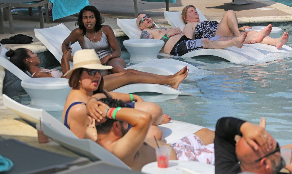 "Older swimmers enjoy the peace and serenity in the ""adults only"" section at JadeWaters, the water park and lazy river at the Hilton Anatole Hotel in Dallas, photographed on Friday, May 26, 2017. (Louis DeLuca/The Dallas Morning News)"