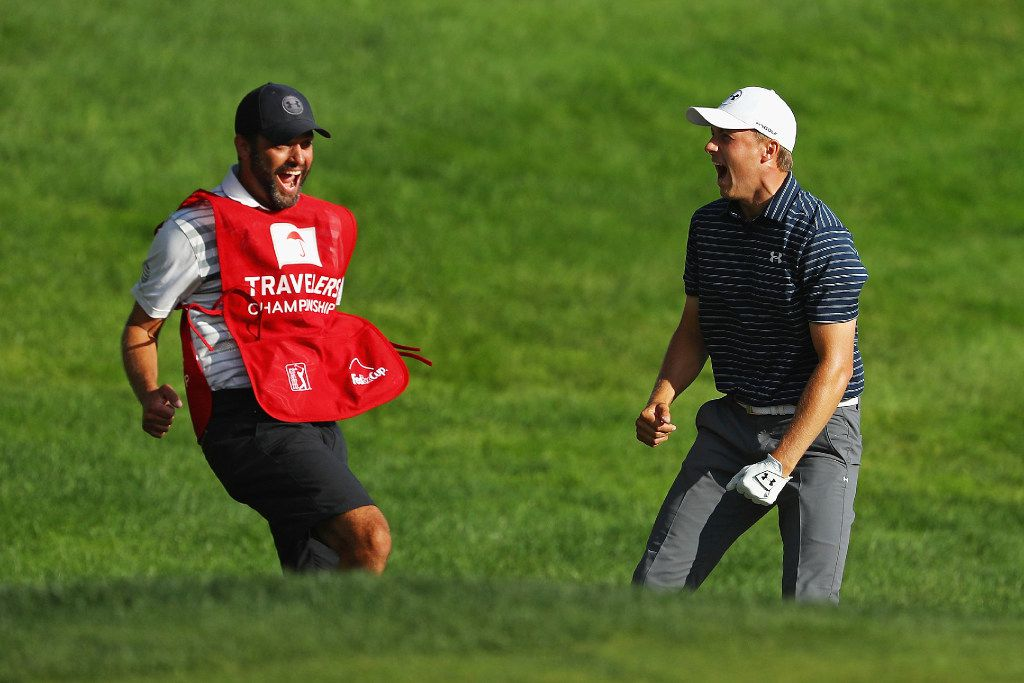 CROMWELL, CT - JUNE 25:  Jordan Spieth of the United States celebrates with caddie Michael Greller after chipping in for birdie from a bunker on the 18th green to win the Travelers Championship in a playoff against Daniel Berger of the United States (not pictured) at TPC River Highlands on June 25, 2017 in Cromwell, Connecticut.  (Photo by Maddie Meyer/Getty Images)