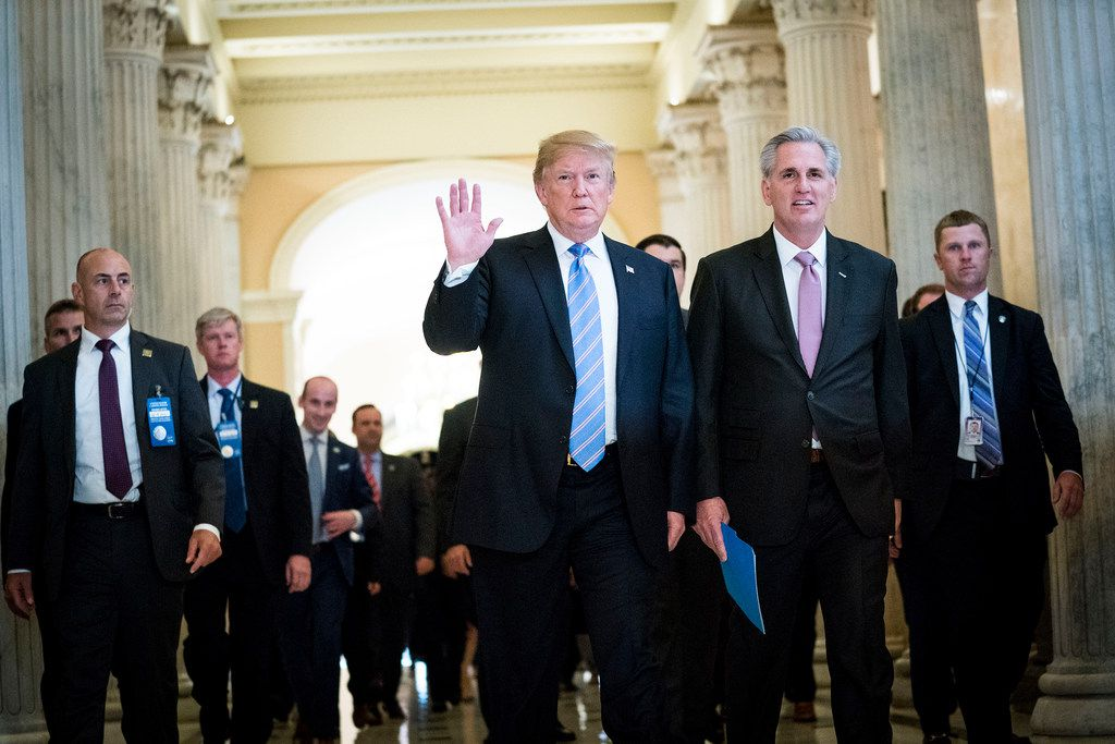 President Donald Trump walks with House Major­ity Leade­r Kevin McCar­thy (R-Ca­lif.) after a House Republican Conference meeting on Capitol Hill in Washington, June 19, 2018. Trump has urged the House to vote on broader immigration bills that would, among other things, fund his border wall.