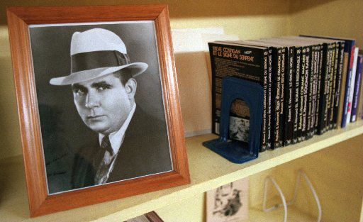 A picture of Robert  E. Howard sits on the shelf of the library along with some foreign editions of his books in Cross Plains.