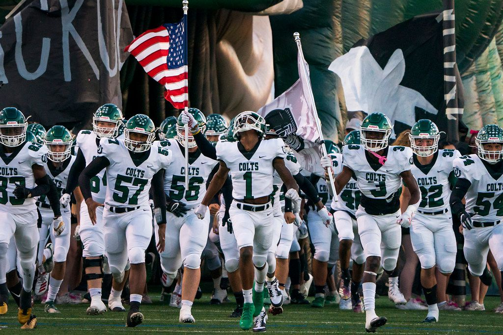 Arlington wide receiver Charles Brown (1) leads his team onto the field to face Arlington Bowie in a high school football game at Wilemon Field on Friday, Oct. 11, 2019, in Arlington, Texas. (Smiley N. Pool/The Dallas Morning News)
