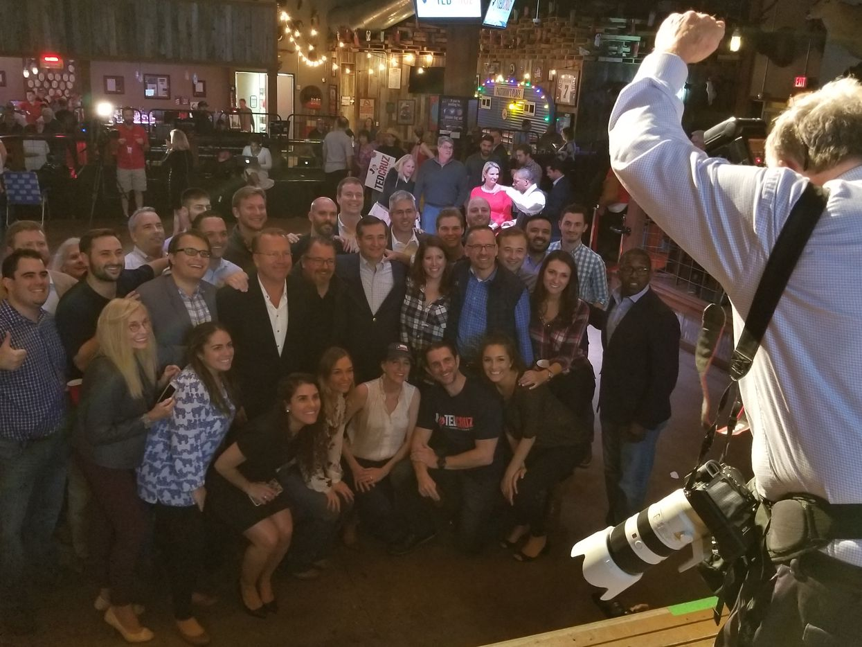 Sen. Ted Cruz, arm around campaign manager Jeff Roe, poses with his campaign staff after his final campaign rally of the 2018 reelection effort, at Redneck Country Club in Stafford, Texas, on Nov. 5, 2018.