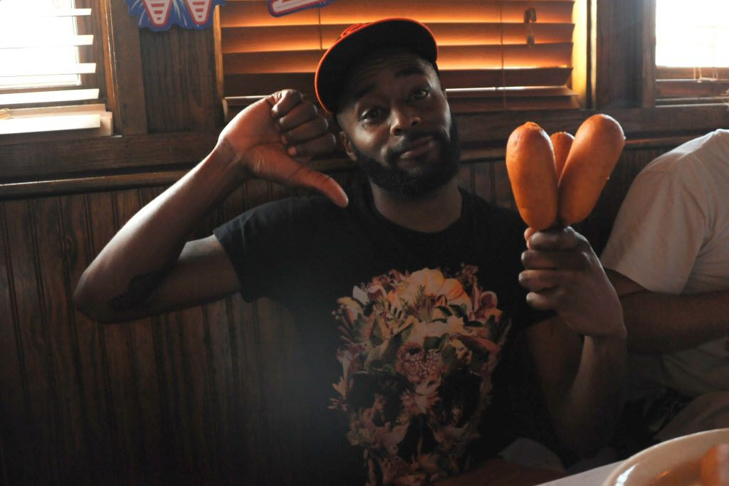 Samuel Shearod taps out at three corn dogs at the 7th annual Brass Knuckles Corn Dog Beatdown at The Libertine Bar on July 4, 2015.