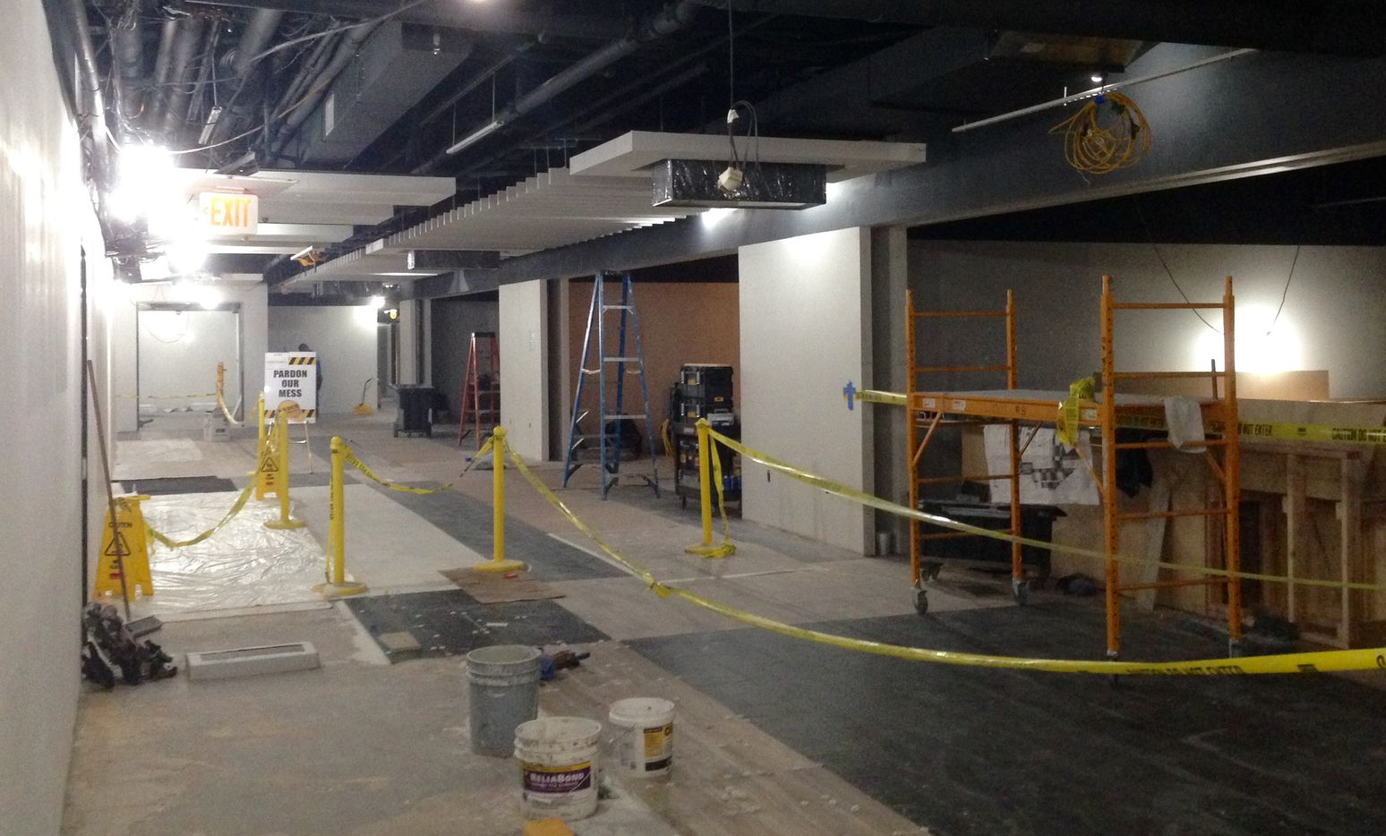 Construction crews are busy building in restaurant and retail space at 1700 Pacific in downtown Dallas.