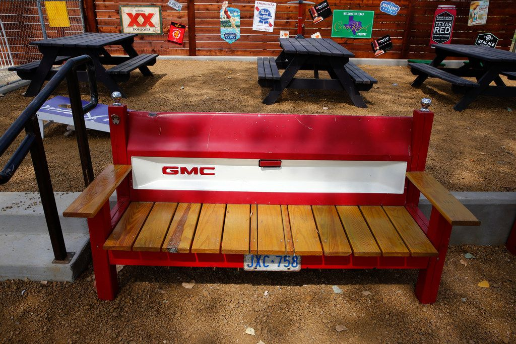 A bench made out of a tailgate in the back patio at Ferris Wheelers Backyard & BBQ in Dallas on Sept. 25, 2017.   (Nathan Hunsinger/The Dallas Morning News)