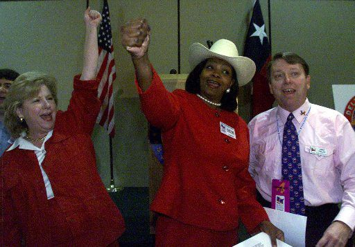 The Gerry Manders -- Flower Mound state Sen. Jane Nelson, Dallas County District Judge Faith Johnson and delegate Larry Phillips -- rally the Texas delegation with songs at a breakfast during the 2000 Republican National Convention in Philadelphia.