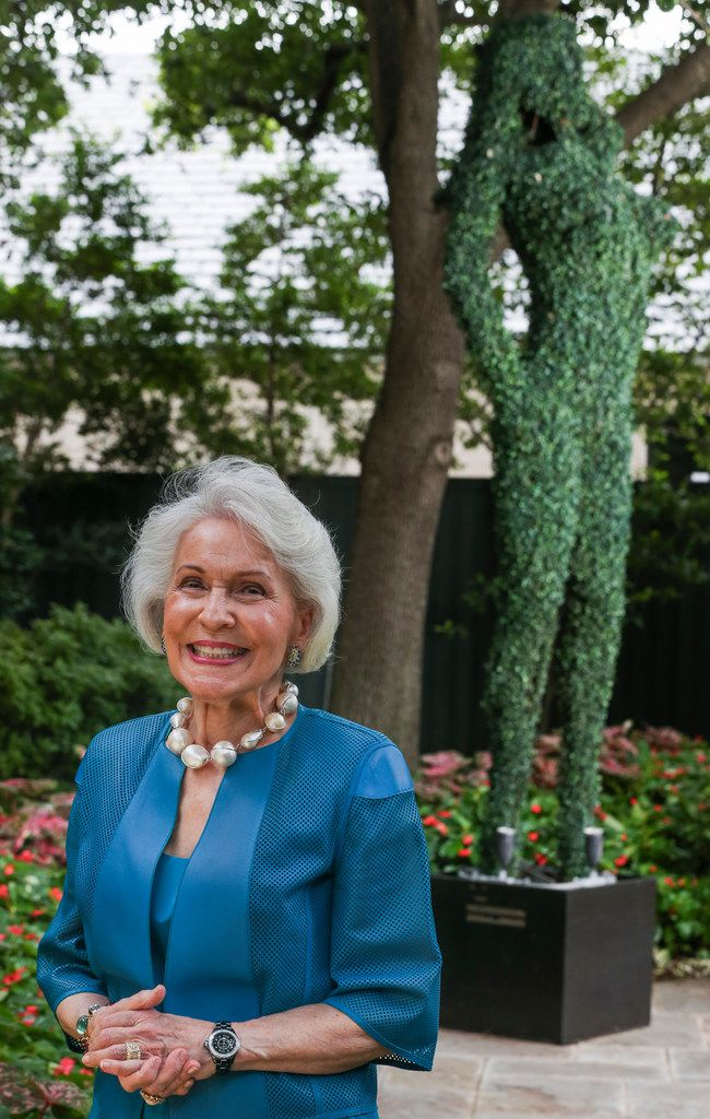 Linda Pitts Custard poses next to her gag gift from Ross Perot.
