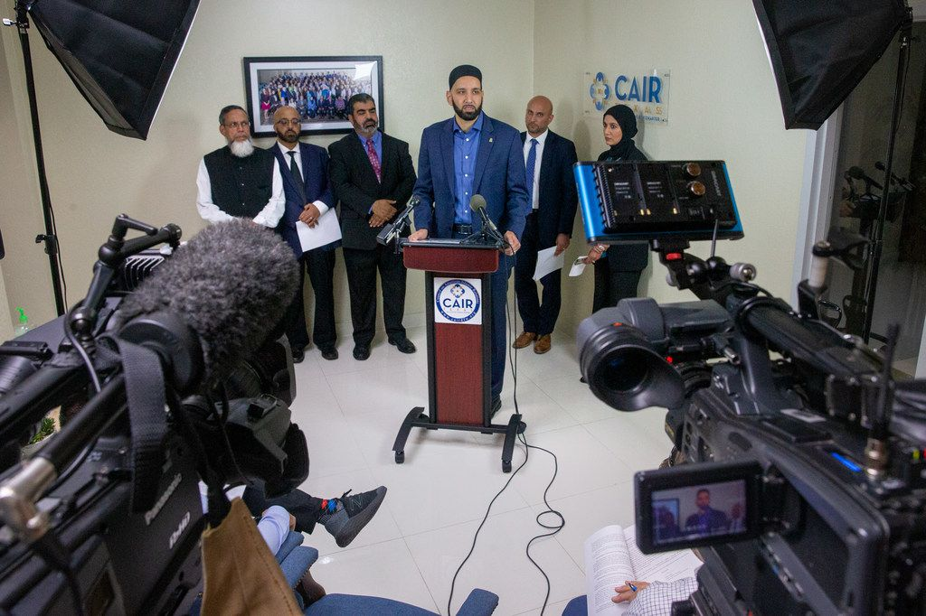"Imam Omar Suleiman (center) said airports are ""a scary place for Muslims,"" as racial profiling instances increase."
