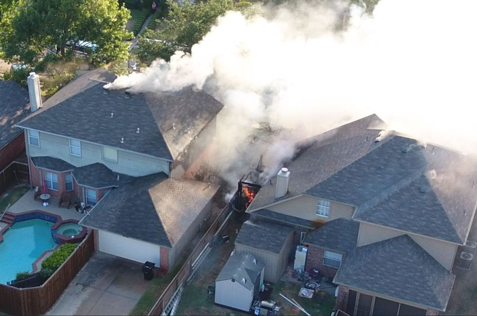 Heavy smoke and fire were showing from two homes in the 8000 block of Burleigh Street when firefighters arrived.