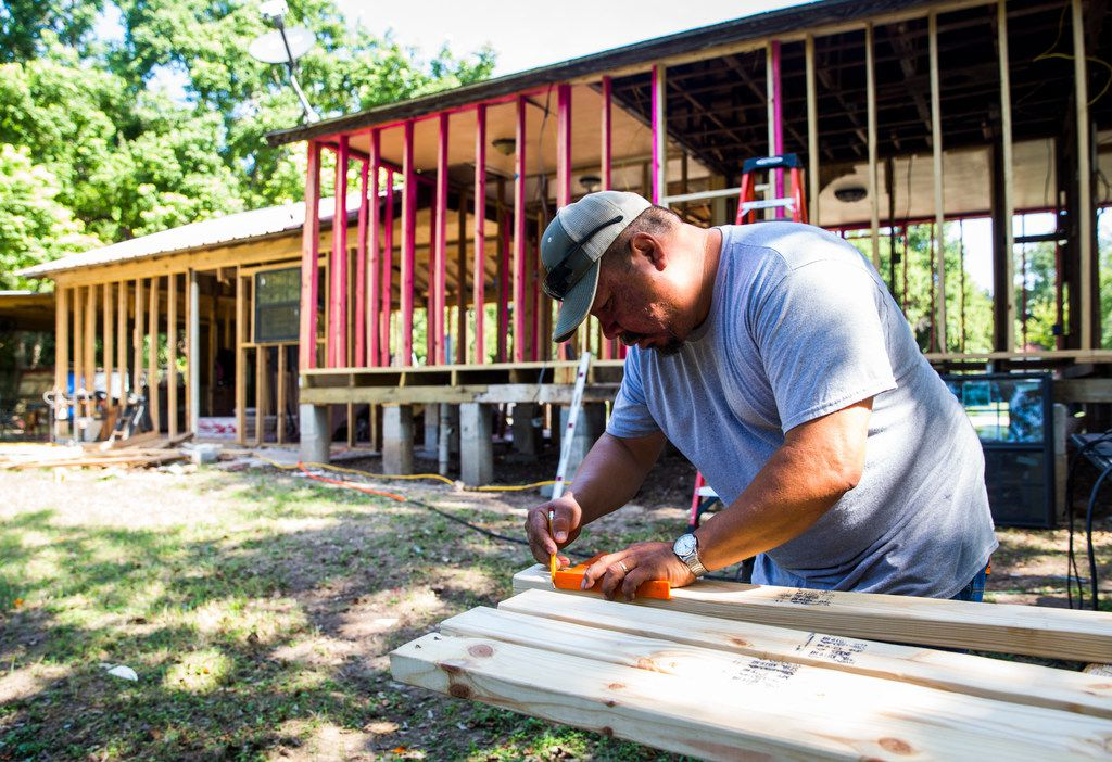 Ricky Villanueva works on his house that had severe flood damage on Wednesday, October 11, 2017 on Colorado Street in La Grange, Texas. Major flooding damaged hundreds of homes in the city due to flooding from Hurricane Harvey in late August. Record amounts of rain caused the Colorado River, which borders La Grange, to raise up about 54 feet. (Ashley Landis/The Dallas Morning News)