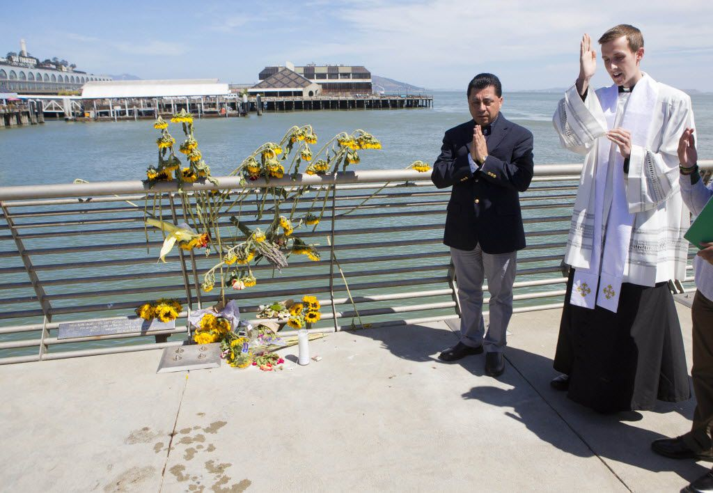 The Rev. Cameron Faller (right) and Julio Escobar of Restorative Justice Ministry conducted a vigil for Kate Steinle in San Francisco in 2015. Steinle was shot and killed by a felon who was set to be deported but was released by local officials. Sen. Ted Cruz, R-Texas, is pushing a measure in Steinle's name to boost mandatory minimum prison sentences for those who re-enter the U.S. illegally.