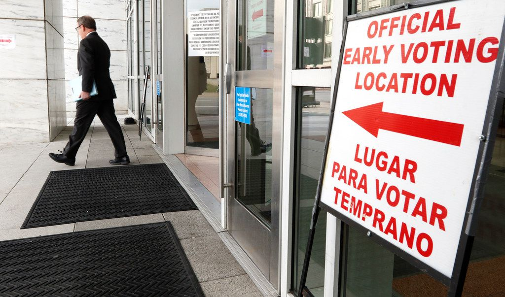 Dallas voter Mike Lee leaves the George L. Allen, Sr. Courts Building, at 600 Commerce St,  on Oct. 22, 2018.