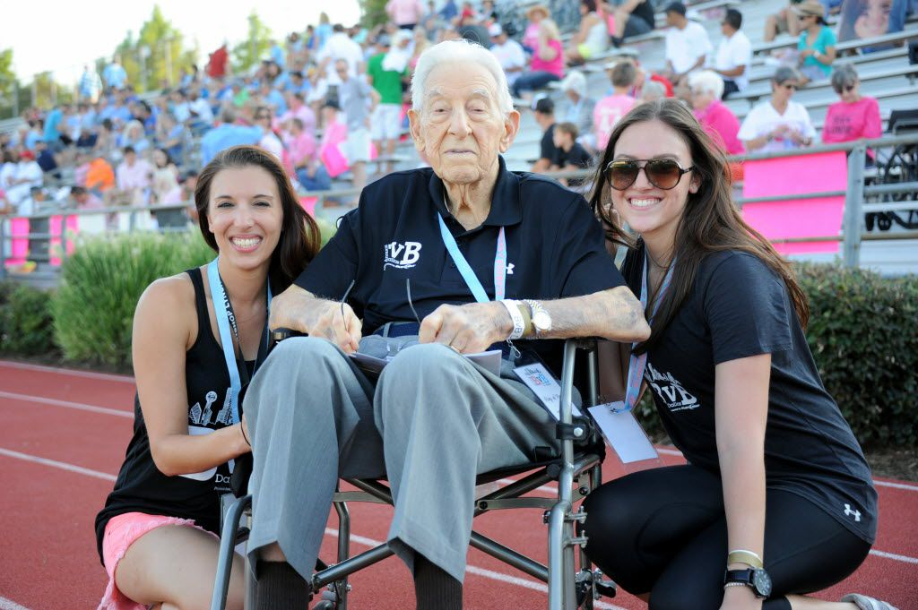 BvB Dallas founder and president Erin Finegold White with her sister Toby Finegold and her grandfather Joe Joe, who was the inspiration for the organization, at the sixth annual Blondes vs. Brunettes Powder-Puff football game at Bishop Lynch High School in Dallas on Aug. 17, 2013.