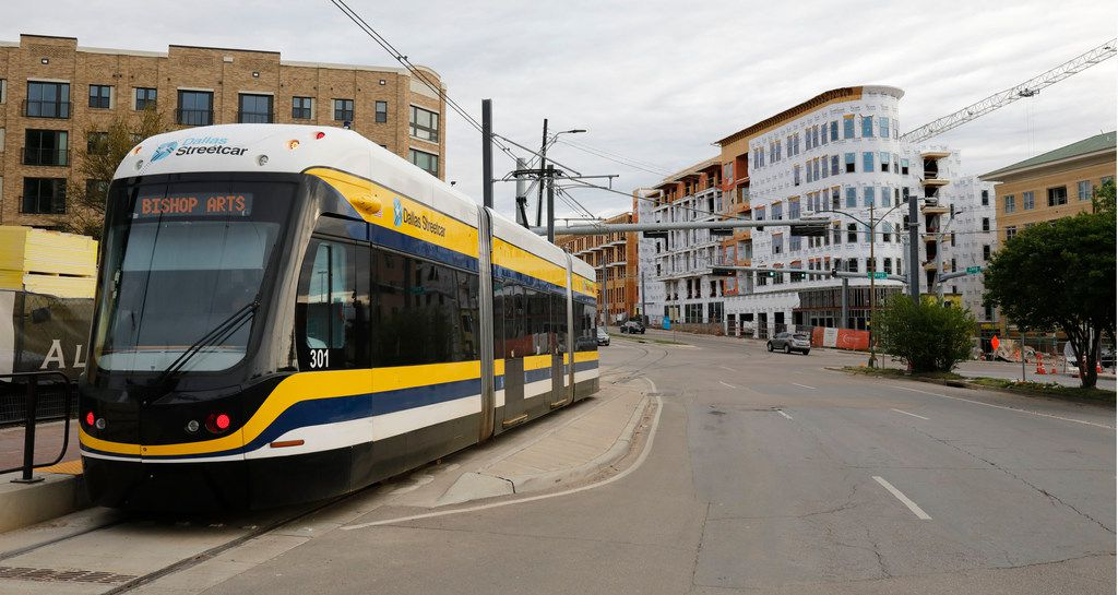 A DART streetcar passes by the corner of Zang Boulevard and Davis Street in Oak Cliff.