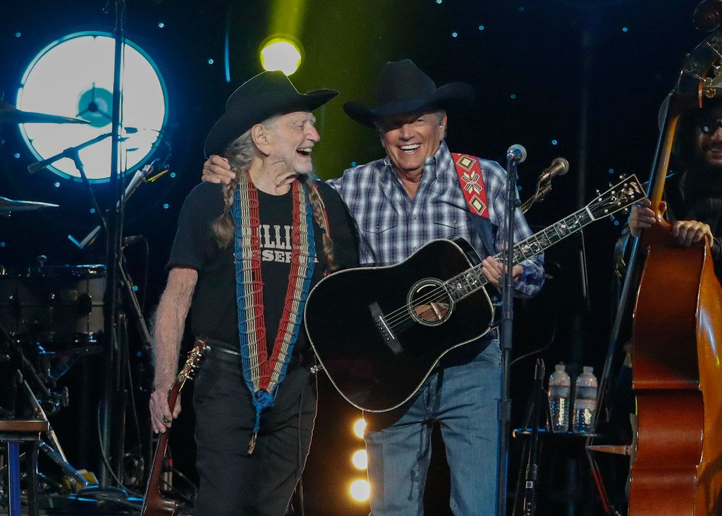 Willie Nelson, left, and George Strait perform at Willie: Life & Songs Of An American Outlaw at Bridgestone Arena on Saturday, Jan. 12, 2019, in Nashville, Tenn.