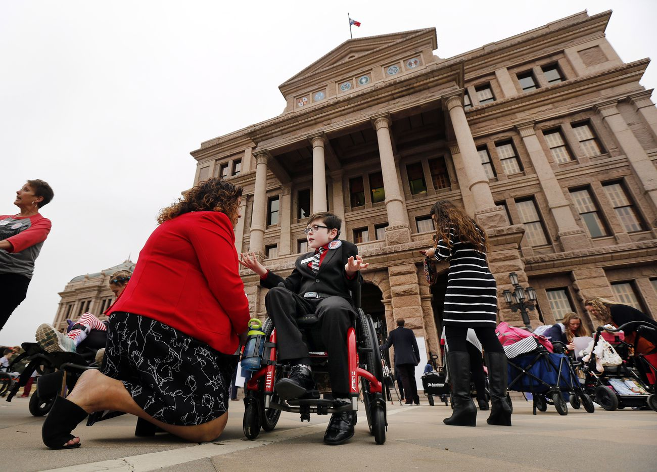 Child ambassador Sam Galinsky, 10 of Arlington (in wheelchair) visits with Clair Milam (left) before their Protect Fragile TX Children rally outside the Texas State Capitol, Tuesday, February 26, 2019.