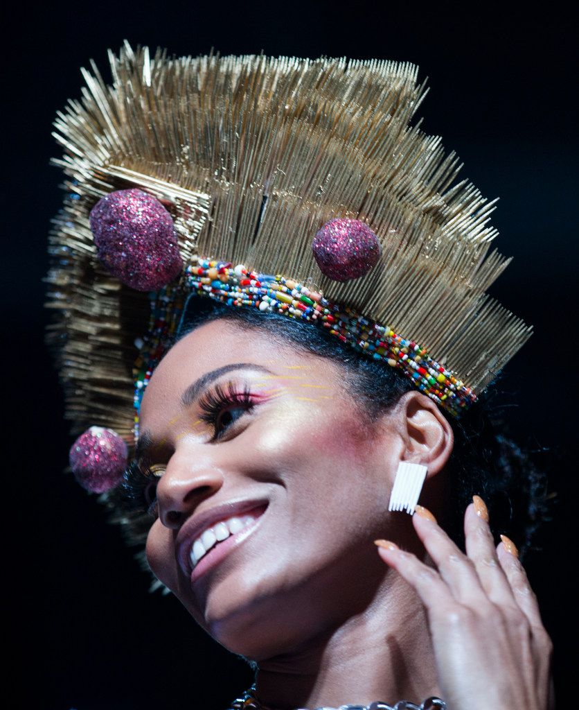 That's right: The third-place winning team dressed its model in a headdress decorated with hundreds of toothpicks and pink glitter biscuits.