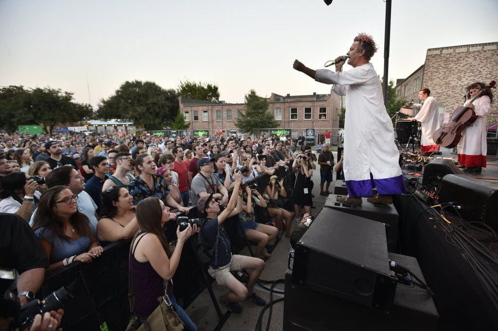 Tim DeLaughter of The Polyphonic Spree stands out on a speaker to get closer to the crowd at the Audacity Brewhouse Main Stage during Oaktopia Fest, Saturday, September 26, 2015, in Denton.