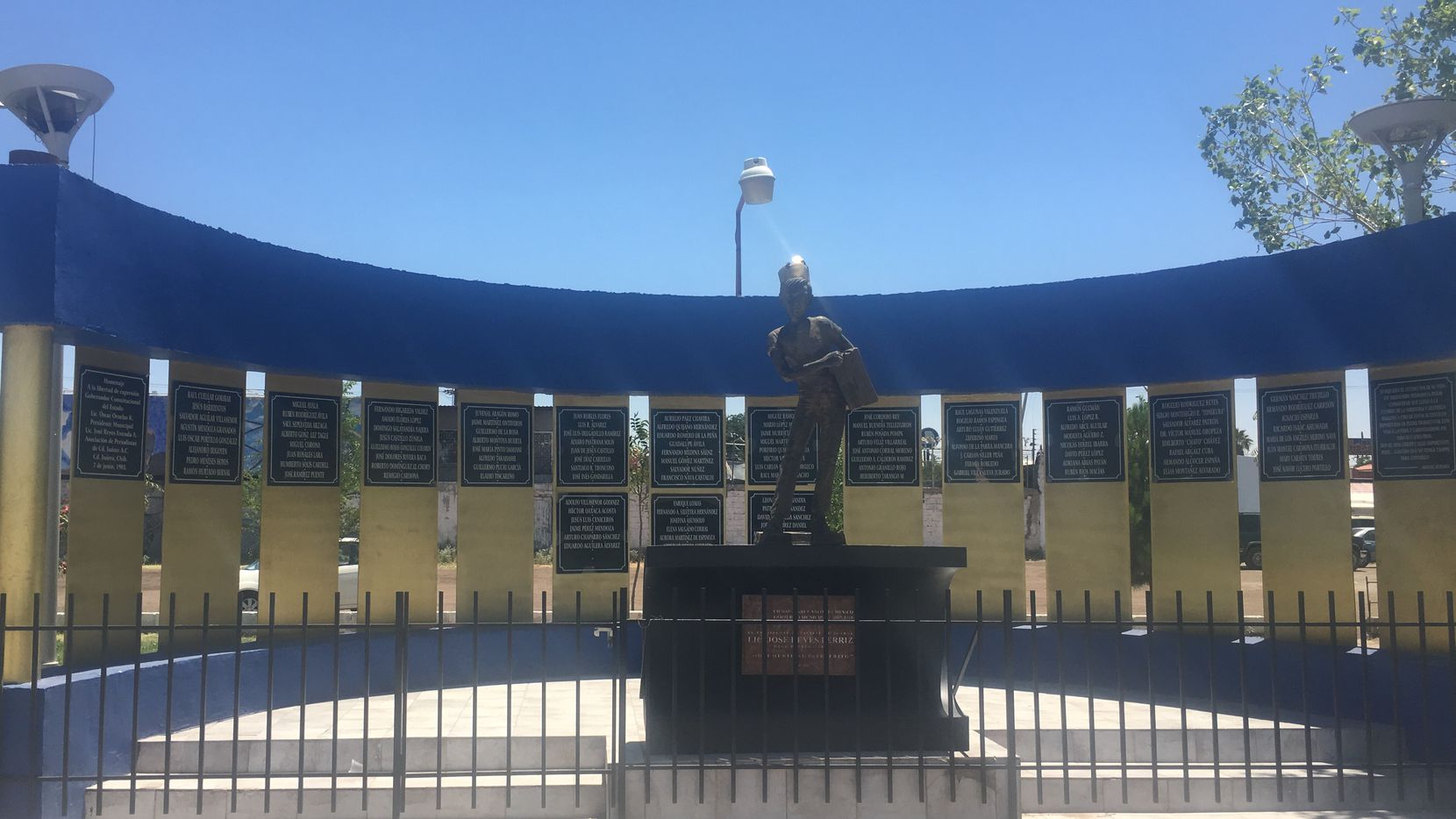 The Plaza del Periodista monument in Ciudad Juarez pays tribute to journalists in the Mexican border city. A sculpture of an old fashioned newspaper boy is the centerpiece. In June 2008 someone left a severed head at the foot of the statue as a warning to journalists. (June 15,2017).