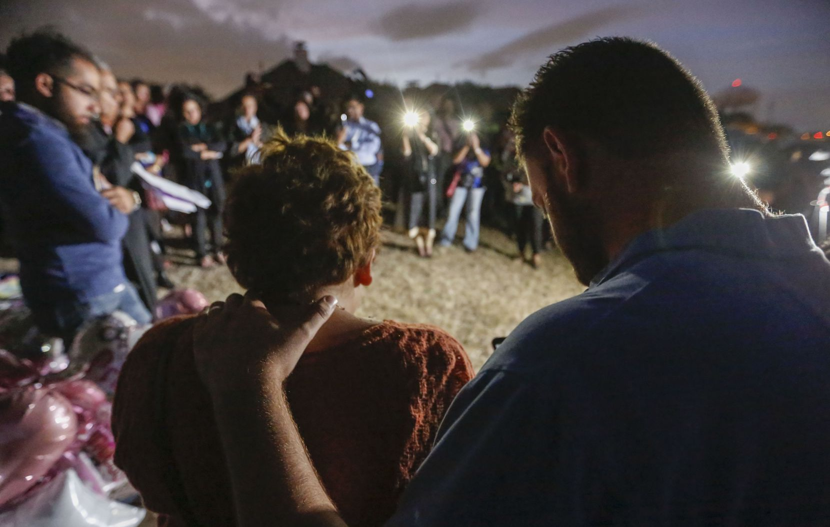 Nicole and Scott Snyder bow their heads in prayer at an Oct. 20 vigil for Sherin Mathews in Richardson. The Snyders created the Finding Sherin Mathews Facebook page and helped organize the vigil.