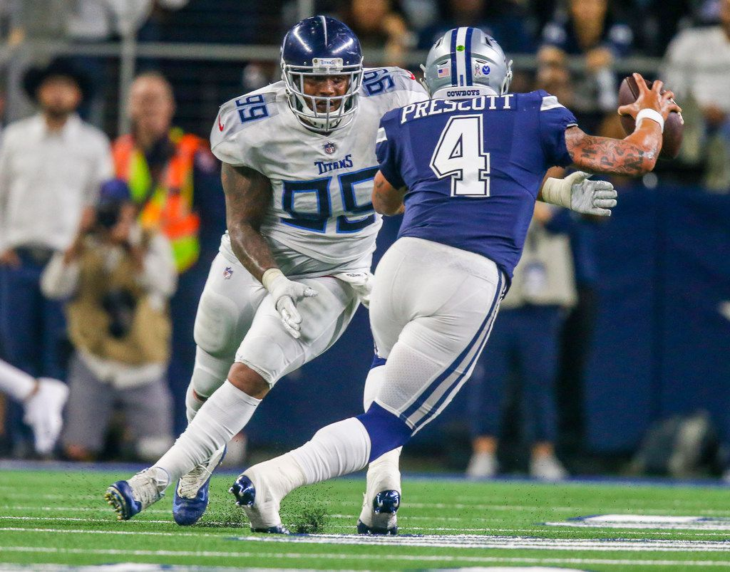 Dallas Cowboys quarterback Dak Prescott (4) attempts to escape a Tennessee Titans defensive end Jurrell Casey (99) tackle during the second half of an NFL game between Dallas Cowboys and Tennessee Titans at AT&T Stadium in Arlington, Texas on Monday, November 5, 2018.