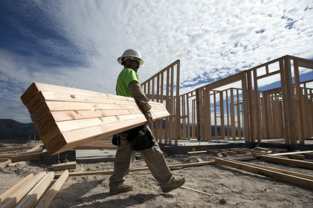 In this Friday, Nov. 16, 2012, photo, construction worker Miguel Fonseca carries lumber as he works on a house frame for a new home  in Chula Vista, Calif. Confidence among U.S. homebuilders inched up in Novemeber to the highest level in more than six and a half years, as builders reported the best market for newly built homes since the housing boom.(AP Photo/Gregory Bull) 12192012xBIZ 01262013xBRIEFING