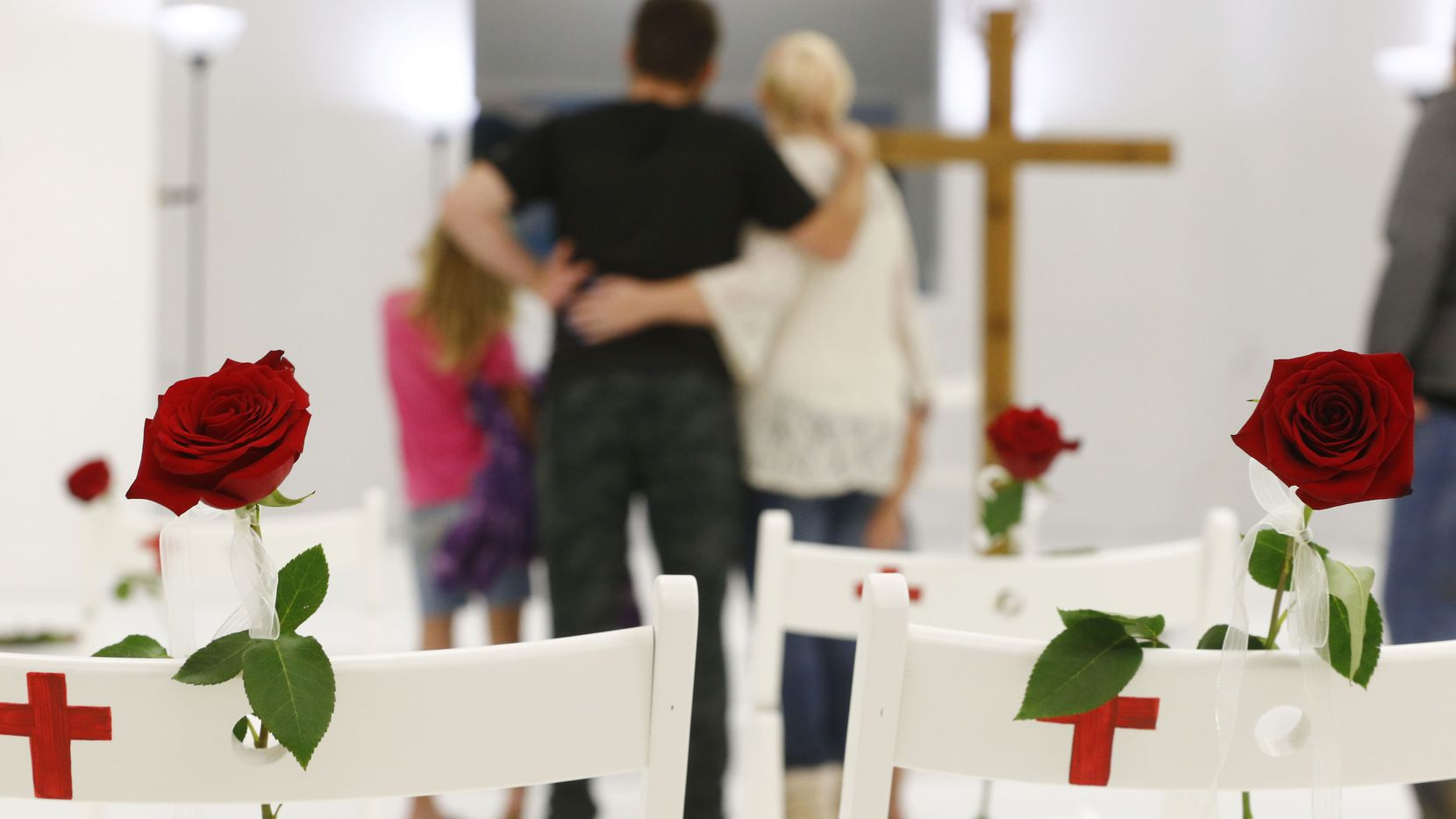 Roses are left on the chairs representing the victims as visitors are allowed into First Baptist Church to pay their respects a week after the shooting in Sutherland Springs, Texas on Nov. 12, 2017. The church was the site of a shooting that killed 26 and left 30 injured. (Nathan Hunsinger/The Dallas Morning News)
