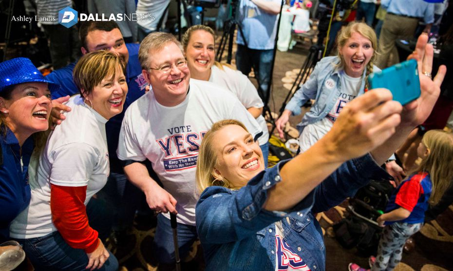 Andrea Proctor takes a selfie as supporters of a new stadium for the Rangers celebrate after early voting gave them an advantage. (Ashley Landis/Staff Photographer)